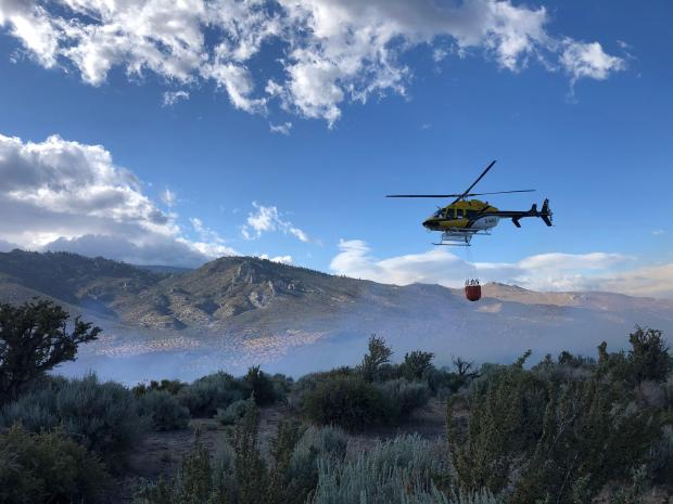 Helicopter 4HX doing bucket work on the Jacks Valley Fire on 6.9.21.