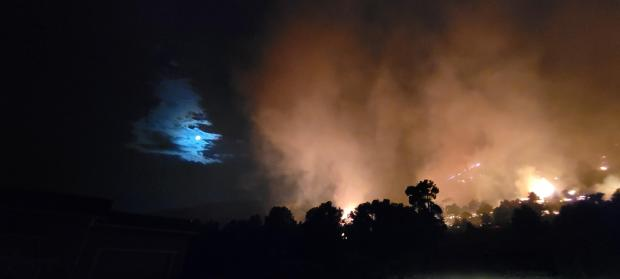 fire at night with moon