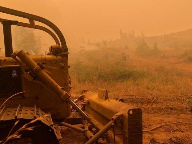 A dozer builds fireline down to bare mineral soil on wildfires in Oregon in 2020