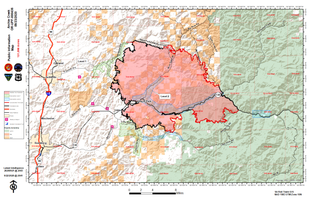 Map showing fire perimeter, containment lines, and evacuation areas