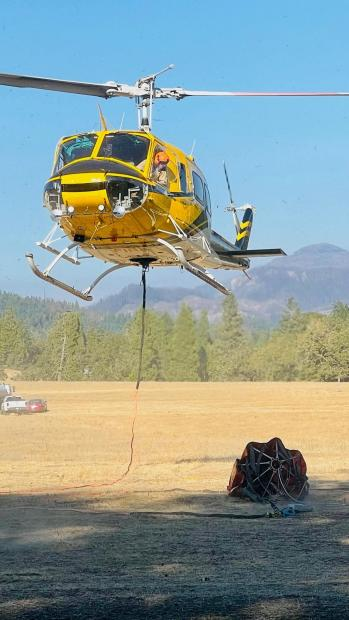 A Bell 205 A1 is a multi-use aircraft. I t can carry up to 325 gallons in a bucket or carry a 9 person crew.