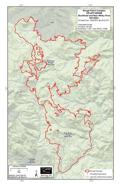 A multi-colored map with a large red border representing a fire's area