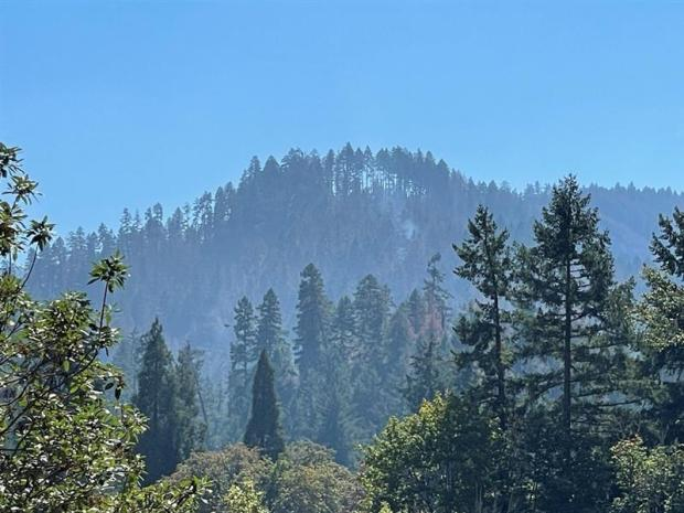 a small smoke column rises on the west side of the Big Hamlin Fire on 9/20
