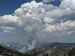 A column of smoke rises from No Name drainage, east of Granite Gulch.