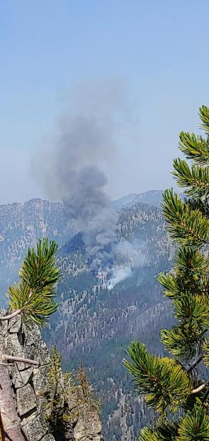 8-20-20 Taken looking northwest at noon, shows fire burning in subalpine fir.
