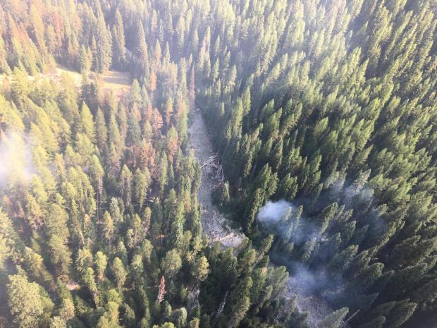 A new spot fire has formed six-tenths of a mile downstream of Elk Creek
