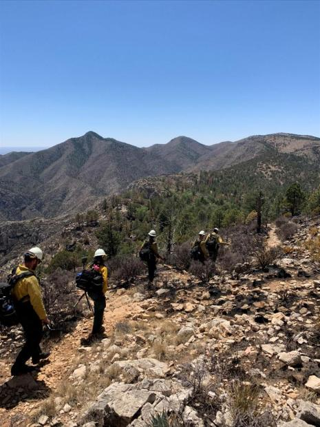 Firefighters hiking fire line.