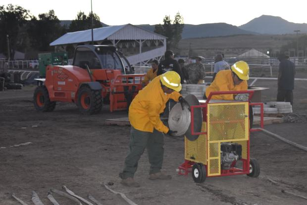 Southern Paiute Agency Crew rolling hose