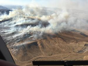 Photo shows smoke rising from a mountain in Division Foxtrot on the east side of the Canal Fire and smoke from a firing operation conducted by firefighters to stop the spread of the main fire.