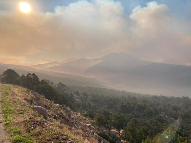 Photo showing smoke and the hills in the Manti La Sal National Forest