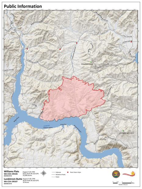 Map showing fire perimeter of 15, 000 acres with 20% containment designated by solid black line.