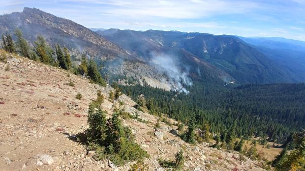 Minimal fire activity, with a small amount of smoke, visible on the Chikamin Fire on Sept. 1, 2020