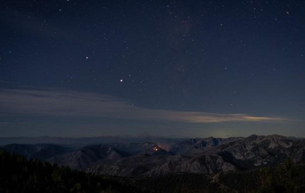 Stars in the nighttime sky over the Chikamin Fire.