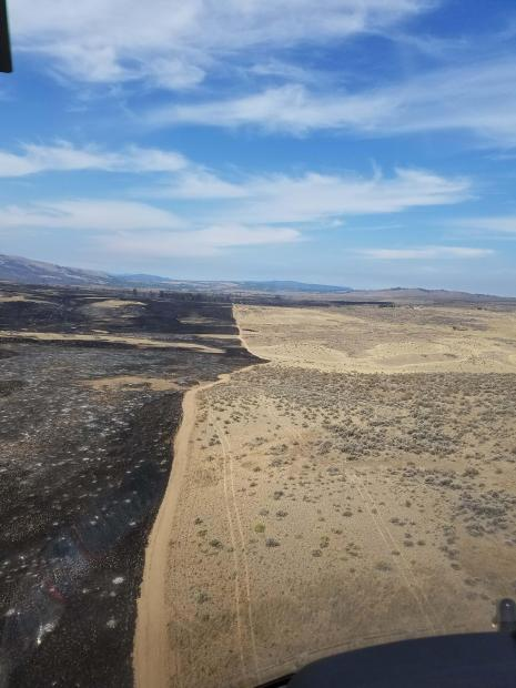 Evans Canyon Fire burns to control line September 5