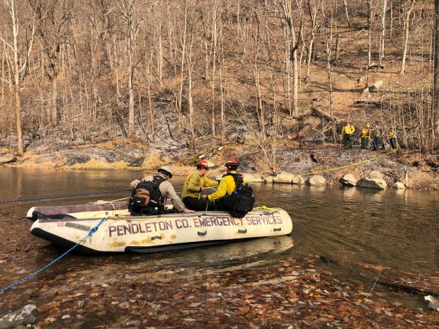 20191129-FS-Monongahela-KMB-1002 Firefighters cross the South Branch of the Potomac in a boat provided by the Upper Tract Volunteer Fire Department to reach the Cave Mountain area during the Dry Hollow Fire near Upper Tract, Pendleton County, Monongahela