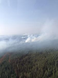 A photo showing haze and smoke on the perimeter of the Lone Star Fire on September 14th.